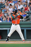 Right fielder Isael Soto (15) of the Greensboro Grasshoppers bats in a game against the Greenville Drive on Thursday, July 14, 2016, at Fluor Field at the West End in Greenville, South Carolina. (Tom Priddy/Four Seam Images)
