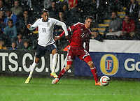 Pictured L-R: Nathan Redmond of England is challenged by Tom O'Sullivan of Wales. Monday 19 May 2014<br />
