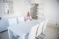 "COPY BY TOM BEDFORD<br /> Pictured: Claire Dix in her dining room<br /> Re: A home-loving mum is looking forward to a bright 2017 - everything she owns is white.  <br /> Claire Dix, 51, lives in white house where all the inside walls, floors and ceilings are white.<br /> Her furniture is white, her sheets and towels are white - even her Persian cat Mr Darcy is white.<br /> She drives a white Porsche sports car and the other family car is - you've guessed, it white.<br /> And to keep her home spotless she even has a white, limited-edition Dyson cleaner.<br /> Claire said: ""It's not an obsession, just a matter of style - I happen to like white."