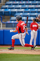 Potomac Nationals left fielder Jack Sundberg (14) follows through on a swing during the first game of a doubleheader against the Salem Red Sox on June 11, 2018 at Haley Toyota Field in Salem, Virginia.  Potomac defeated Salem 9-4.  (Mike Janes/Four Seam Images)