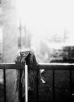 Mop hanging over railing<br />