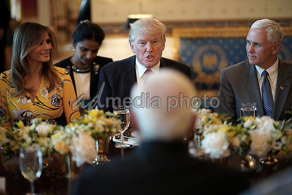 United States President Donald Trump (C), flanked by first lady Melania Trump (L) and Vice President Mike Pence (R), delivers remarks before dinner with Indian Prime Minister Narendra Modi (C) at the White House June 26, 2017 in Washington, DC. Trump and Modi met earlier today in the Oval Office to discuss a range of bilateral issues. Photo Credit: Win McNamee/CNP/AdMedia