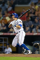 J.P. Arencibia (16) of the Durham Bulls follows through on his swing against the Scranton/Wilkes-Barre RailRiders at Durham Bulls Athletic Park on May 15, 2015 in Durham, North Carolina.  The RailRiders defeated the Bulls 8-4 in 11 innings.  (Brian Westerholt/Four Seam Images)