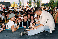 File Photo Montreal (Quebec) CANADA<br /> Marc Dupre sign autographs at a Juste Pour Rire show outside.<br /> Photo (c) P Roussel / AQP