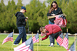 Volunteers, from left, Steven and Nick Arraiz, both 9, and their mom Pam Christensen place flags on the graves of veterans at the Lone Mountain Cemetery in Carson City, Nev., on Friday, May 25, 2012. More than 1,400 flags were placed in honor of Memorial Day..Photo by Cathleen Allison