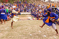 asia,India,Punjab, Anandpur Sahib, Nihang or Sikh warriors seen performing gatka (mock encounter with real weapons) during the annual fair of 'Hola Mohalla'