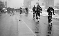 Milan - San Remo 2013: the iced edition<br /> peloton searching for the team buses after the race is  neutralised