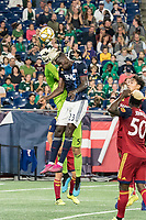 FOXBOROUGH, MA - SEPTEMBER 21: Wilfried Zahibo #23 of New England Revolution heads the ball out of Andrew Putna #51 of Real Salt Lake's hand during a game between Real Salt Lake and New England Revolution at Gillette Stadium on September 21, 2019 in Foxborough, Massachusetts.