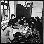 """After work, they spend hours studying Mao's works and reading Party-controlled newspapers such as the China Youth Daily, including this one with the headline """"Vietnamese troops shoot down twelve American planes for a total of over one hundred in seven months.""""  Ashihe commune, Acheng county, 18 April, 1965"""