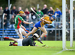 Brian Corry of Sixmilebridge in action against Donnchadh Murphy and Keith Hogan of Clooney-Quin during their senior county final replay at Cusack park. Photograph by John Kelly.