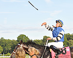 8.14.10 Jockey Garret Gomez launches his stick after winning the Sword Dancer Invitational with Telling