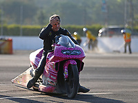 Nov 11, 2017; Pomona, CA, USA; NHRA pro stock motorcycle rider Jerry Savoie reacts after going into the sand trap during qualifying for the Auto Club Finals at Auto Club Raceway at Pomona. Mandatory Credit: Mark J. Rebilas-USA TODAY Sports