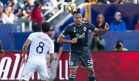 CARSON, CA - SEPTEMBER 29: Theo Bair #50 of the Vancouver Whitecaps heads a ball during a game between Vancouver Whitecaps and Los Angeles Galaxy at Dignity Health Sports Park on September 29, 2019 in Carson, California.