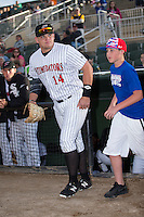 Corey Zangari (14) of the Kannapolis Intimidators takes the field with a youth baseball player prior to the game against the Hagerstown Suns at Kannapolis Intimidators Stadium on May 6, 2016 in Kannapolis, North Carolina.  The Intimidators defeated the Suns 5-3.  (Brian Westerholt/Four Seam Images)