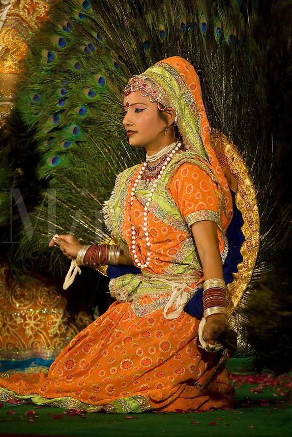 A play stars RHADA as KRISHNA'S COSORT during the GANGUR FESTIVAL or MEWAR FESTIVAL - UDAIPUR, RAJASTHAN, INDIA