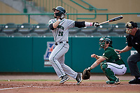 Dartmouth Big Green left fielder Ubaldo Lopez (26) follows through on a swing in front of catcher Tyler Dietrich (38) and home plate umpire Rick Darby during a game against the USF Bulls on March 17, 2019 at USF Baseball Stadium in Tampa, Florida.  USF defeated Dartmouth 4-1.  (Mike Janes/Four Seam Images)
