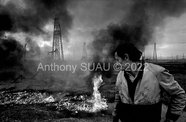 """Karbunara, Albania<br /> February 1997<br /> <br /> """"The Iron Forest"""" is a vast landscape of oil drilling rigs across a flat plain. They function at the lowest capacity and pump only the lowest grade of oil. It is one of the few industries functioning in Albania today."""