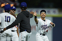 Ivan Gonzalez (45) of the Kannapolis Cannon Ballers celebrates with teammates following the first home win in Cannon Ballers history at Atrium Health Ballpark on May 21, 2021 in Kannapolis, North Carolina. (Brian Westerholt/Four Seam Images)