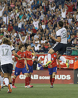 USWNT substitute forward Abby Wambach (20) celebratratory jump after scoring on penalty kick. In an international friendly, the U.S. Women's National Team (USWNT) (white/blue) defeated Korea Republic (South Korea) (red/blue), 4-1, at Gillette Stadium on June 15, 2013.