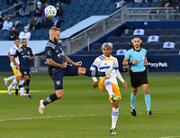 KANSAS CITY, KS - NOVEMBER 22: Johnny Russell #7 of Sporting KC heads the ball as Judson #93 of the San Jose Earthquakes keeps an eye on him before a game between San Jose Earthquakes and Sporting Kansas City at Children's Mercy Park on November 22, 2020 in Kansas City, Kansas.