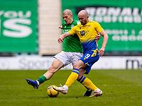 1st May 2021; Easter Road, Edinburgh, Scotland; Scottish Premiership Football, Hibernian versus St Johnstone;  Chris Kane of St Johnstone and Alex Gogic of Hibernian compete for possession of the ball