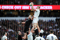 Substitute George Kruis of England secures the lineout ball during the QBE International match between England and New Zealand at Twickenham Stadium on Saturday 8th November 2014 (Photo by Rob Munro)