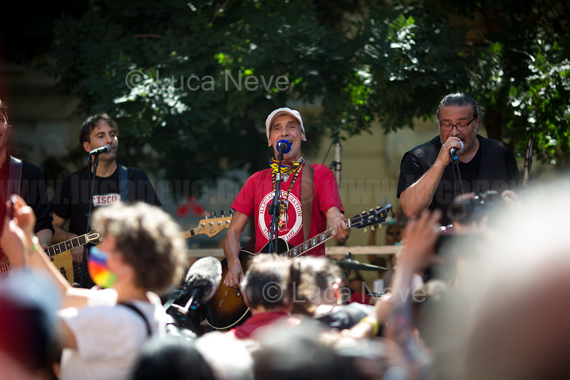 """Manu Chao, Musician.<br /> <br /> Genoa (Genova, Liguria), Italy. 19th, 20th, 21st July 2021. Twenty years after the dramatic and terrifying events related to the 2001 Genoa's G8 meeting, according to Amnesty International: """"the most serious suspension of democratic rights in a Western country since the Second World War"""" (1.) and as stated on the 2001 """"Report on the situation of fundamental rights in the EU"""" the European Parliament's """"deplores the suspensions of fundamental rights that took place during public demonstrations, and in particular at the G8 meeting in Genoa, such as freedom of expression, freedom of movement, the right to physical integrity"""" (2.). As a reminder, the City of Genoa is State Gold Medal (Medaglia D'Oro) for its Antifascist Resistance in World War II.<br /> <br /> In these three days, throughout a series of events, Genoa and its People, survivors and witnesses, experts and activists, remembered what happened 20 years ago, discussed the present situation of a world dominated by """"casino capitalism"""", predatory neo-liberalism, wars, rightless globalization, environmental and ecosystem degradation, doped consumerism, sources' depredation, fake news, internet deregulated jungle, the reality of climate change and pandemics, and what a different future and society could be.<br /> <br /> FOR MORE INFO READ THE ARTICLE AT THE BEGINNING OF THIS STORY.<br /> <br /> Footnotes, Links:<br /> 1. http://bit.do/fRvdg<br /> 2. http://bit.do/fRvdi<br /> 3. http://bit.do/fRvdj<br /> 4. http://bit.do/fRvdn<br /> 5. http://bit.do/fRvdo<br /> 6. 12.10.18 - Sulla Mia Pelle: Stefano Cucchi's Film Screening At CSOA La Strada http://bit.do/fRvdr<br /> 7. http://bit.do/fRvdt & http://bit.do/fRvdu<br /> 8. http://bit.do/fRvdv & http://bit.do/fRvdw & http://bit.do/fRvdx<br /> 9. http://bit.do/fRvdz<br /> 10. http://bit.do/fRvdA<br /> 11. http://bit.do/fRvdB<br /> http://www.veritagiustizia.it/docs/G8_2021_prog_ITA.pdf http://www.veritagiustizia.it/doc_eng/<br /> https://w"""