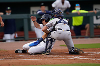 Darryl Collins (23) of the Columbia Fireflies is out at home as catcher Jonathan Embry (1) of the Charleston RiverDogs makes the tag on Tuesday, May 11, 2021, at Segra Park in Columbia, South Carolina. (Tom Priddy/Four Seam Images)