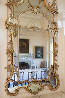 The rococo mirrors are by Edinburgh furniture maker William Mathie, one of the fashionable craftsmen of his day and much favoured by the Adam brothers. He also supplied pieces for Dumfries House