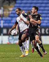Bolton Wanderers' Nathan Delfouneso competing with Oldham Athletic's Ben Garrity (right) <br /> <br /> Photographer Andrew Kearns/CameraSport<br /> <br /> The EFL Sky Bet League Two - Bolton Wanderers v Oldham Athletic - Saturday 17th October 2020 - University of Bolton Stadium - Bolton<br /> <br /> World Copyright © 2020 CameraSport. All rights reserved. 43 Linden Ave. Countesthorpe. Leicester. England. LE8 5PG - Tel: +44 (0) 116 277 4147 - admin@camerasport.com - www.camerasport.com