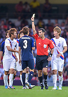 August 10, 2012..Match referee assesses a yellow card during bronze medal match at the Millennium Stadium on day fourteen in Cardiff, England. Korea defeat Japan 2-0 to win Olympic bronze medal in men's soccer. ..