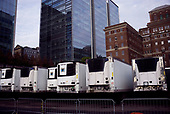 April 21, 2020<br /> New York, New York<br /> <br /> Behind NYU Medical Center and Tisch Hospital are many cooled trailers holding those who died of coronavirus during the coronavirus pandemic.