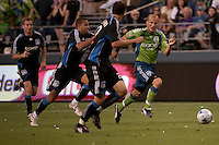 Freddie Ljungberg (r) drives against several San Jose players in the Seattle Sounders 2-1 win against San Jose Earthquake on Saturday, June 13, 2009 at Quest Field in Seattle, WA.