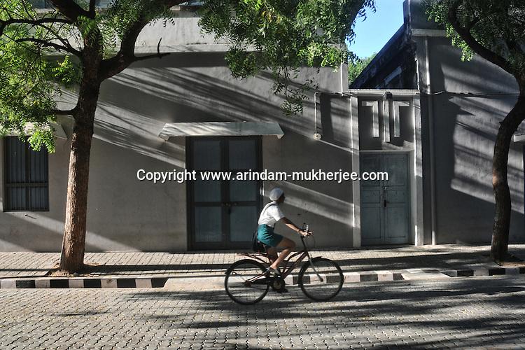 A bycycle rider in front of Arobindo Ashram building in Pondicherry. Arindam Mukherjee..