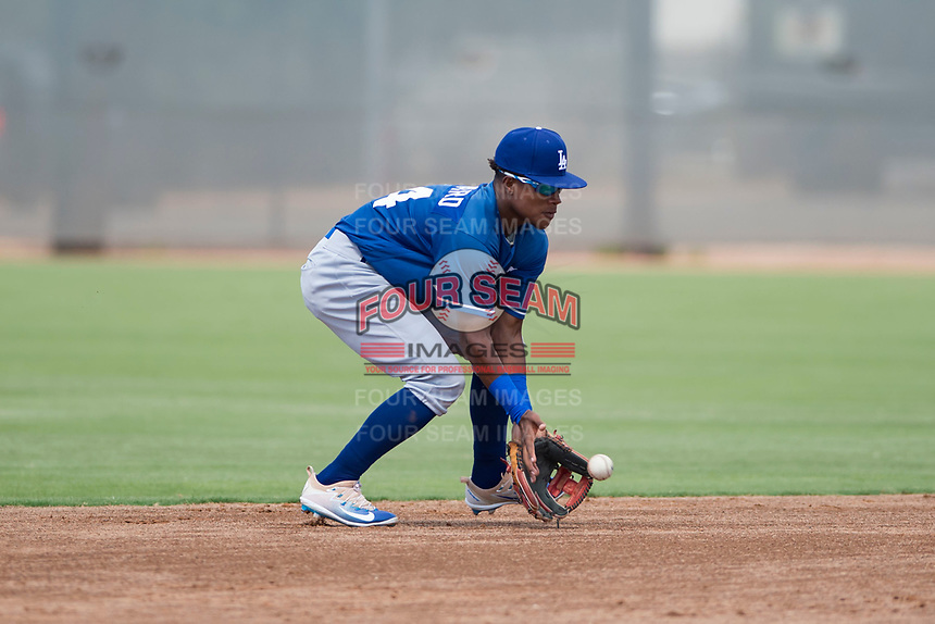 Los Angeles Dodgers shortstop Eddys Leonard (84) fields a ground ball during an Instructional League game against the Milwaukee Brewers at Maryvale Baseball Park on September 24, 2018 in Phoenix, Arizona. (Zachary Lucy/Four Seam Images)