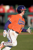 Right fielder Elijah Henderson (6) of the Clemson Tigers runs toward first in a game against the Stony Brook Seawolves on Friday, February 21, 2020, at Doug Kingsmore Stadium in Clemson, South Carolina. Clemson won, 2-0. (Tom Priddy/Four Seam Images)
