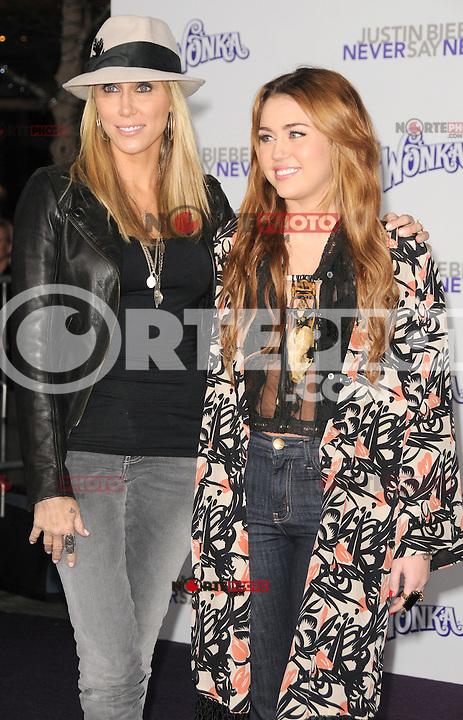 """Tish Cyrus and Miley Cyrus at the Los Angeles premiere of """"Justin Bieber: Never Say Never""""  at Nokia Theater at L.A. Live in Los Angeles, CA, USA.February 8, 2011 © mpi11 / MediaPunch Inc. / NortePhoto.com.<br /> <br /> <br /> **CREDITO*OBLIGATORIO** *No*Venta*A*Terceros*<br /> *No*Sale*So*third* ***No*Se*Permite*Hacer Archivo***No*Sale*So*third*©Imagenes*con derechos*de*autor©todos*reservados*."""