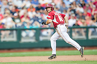Arkansas Razorbacks outfielder Andrew Benintendi (16) runs to third base against the Virginia Cavaliers in Game 1 of the NCAA College World Series on June 13, 2015 at TD Ameritrade Park in Omaha, Nebraska. Virginia defeated Arkansas 5-3. (Andrew Woolley/Four Seam Images)