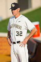 Wake Forest Demon Deacons head coach Tom Walter #32 looks on as his starting pitcher warms up in the bullpen prior to the game against the Charlotte 49ers at Gene Hooks Field on March 22, 2011 in Winston-Salem, North Carolina.   Photo by Brian Westerholt / Four Seam Images