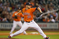 Houston Astros starting pitcher Bud Norris (20) delivers a pitch during the MLB baseball game against the Detroit Tigers on May 3, 2013 at Minute Maid Park in Houston, Texas. Detroit defeated Houston 4-3. (Andrew Woolley/Four Seam Images).