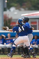 Burlington catcher Tom Hill (44) tries to reach around Kingsport left fielder Daniel Clark (23) at Burlington Athletic Park in Burlington, NC, Monday, July 30, 2007.