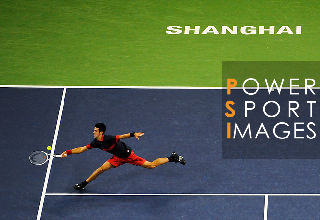 SHANGHAI, CHINA - OCTOBER 16:  Novak Djokovic of Serbia returns a ball to  Roger Federer of Switzerland during day six of the 2010 Shanghai Rolex Masters at the Shanghai Qi Zhong Tennis Center on October 16, 2010 in Shanghai, China.  (Photo by Victor Fraile/The Power of Sport Images) *** Local Caption *** Novak Djokovic