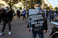 """Rome, 21/10/2020. Today, MIO Italia and Italian Hospitality Network (IHN) held a demonstration (1.) outside the Italian Ministry of Economy to highlight the dramatic situation of the Hospitality Industry in Italy during the so called """"second wave"""" of the pandemic Covid-19/Coronavirus, to call the Government to act for immediate investments, aids, and policies to save their industry, and to protest against the mainstream media accused by protesters of demonising the Hospitality Industry. From the organisers Facebook event page: «The hospitality industry, the administration, the businesses linked to the world of nightlife and entertainment, come into action. A [State] administration simply absent! Months and months of lost promises and aid, a complete lack of planning to predict a possible second wave [of the Covid-19/Coronavirus, ndr], combined with a continuous demonization by politicians and puppet newspapers, are bringing the world of hospitality to collapse. Our voice has gone unheard for too long. Time to make it heard […]».<br /> <br /> Footnotes & Links: <br /> 1. https://www.facebook.com/events/396888301314782/"""