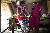 Dr. Sharon Cynthia speaks to 5 months pregnant Reena Devi in her hut in Bhelaiya village in Raxaul district in Bihar, India.
