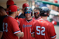 Rochester Red Wings designated hitter Matt Hague (13) high fives teammates in the dugout during a game against the Columbus Clippers on August 9, 2017 at Frontier Field in Rochester, New York.  Rochester defeated Columbus 12-3.  (Mike Janes/Four Seam Images)