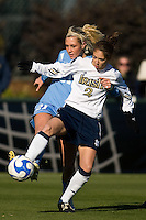 Notre Dame Fighting Irish forward Kerri Hanks (2) battles North Carolina Tar Heels midfielder Allie Long (21) for the ball. The North Carolina Tar Heels defeated the Notre Dame Fighting Irish 2-1 during the finals of the NCAA Women's College Cup at Wakemed Soccer Park in Cary, NC, on December 7, 2008. Photo by Howard C. Smith/isiphotos.com