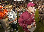 Florida State head coach Jimbo Fisher walks away while Clemson head coach Dabo Swinney talks to Fisher's son, Trey, after Clemson defeated Florida State 37-34 in an NCAA college football game in Tallahassee, Fla., Saturday, Oct. 29,2016. Clemson defeated Florida State 37-34. (AP Photo/Mark Wallheiser)