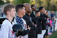 Kannapolis Intimidators manager Justin Jirschele (second from left) and hitting coach Jamie Dismuke stand for the National Anthem prior to the game against the Lakewood BlueClaws at Kannapolis Intimidators Stadium on April 7, 2017 in Kannapolis, North Carolina.  The BlueClaws defeated the Intimidators 6-4.  (Brian Westerholt/Four Seam Images)
