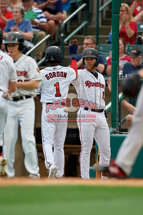 Rochester Red Wings Nick Gordon (1) high fives Zander Wiel (12) after scoring a run during an International League game against the Pawtucket Red Sox on June 28, 2019 at Frontier Field in Rochester, New York.  Pawtucket defeated Rochester 8-5.  (Mike Janes/Four Seam Images)