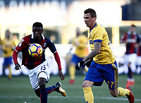 Calcio, Serie A: Bologna vs Juventus, stadio Renato D'Allara, Bologna,17 dicembre 2017.<br /> Juventu's Mario Mndzukic (r) in action with Mbaye Ibrahima (l) during the Italian Serie A football match between Bologna and Juventus at Bologna's Renato D'Allara stadium, December 17, 2017.<br /> UPDATE IMAGES PRESS/Isabella Bonotto
